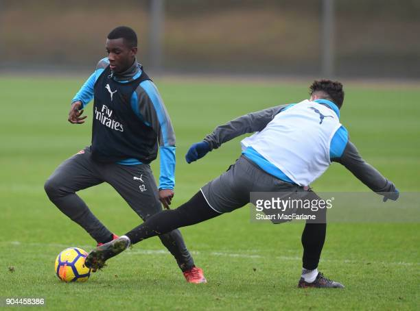 Eddie Nketiah and Granit Xhaka of Arsenal during a training session at London Colney on January 13 2018 in St Albans England