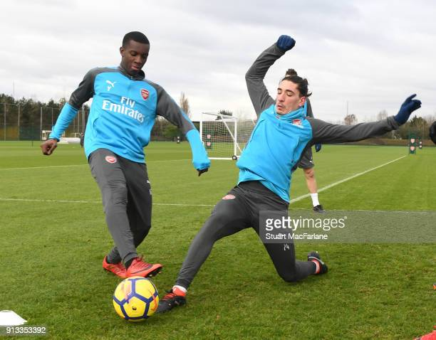 Eddie Nketiah and Hector Bellerin of Arsenal during a training session at London Colney on February 2 2018 in St Albans England