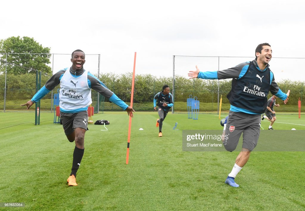 Eddie Nketiah and Henrikh Mkhitaryan of Arsenal during a training session at London Colney on May 12, 2018 in St Albans, England.