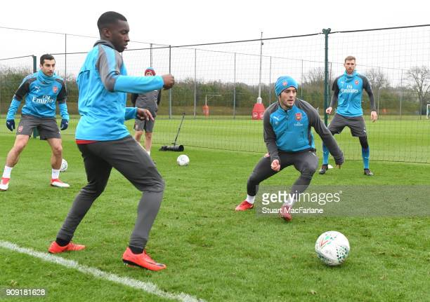 Eddie Nketiah and Jack WIlshere of Arsenal during a training session at London Colney on January 23 2018 in St Albans England