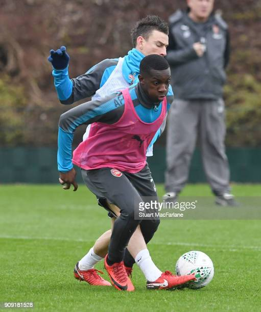 Eddie Nketiah and Laurent Koscielny of Arsenal during a training session at London Colney on January 23 2018 in St Albans England