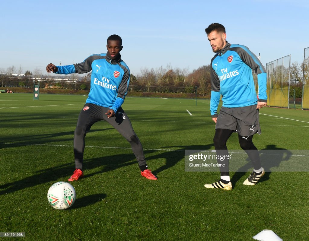 Eddie Nketiah and Mathieu Debuchy of Arsenal during a training session at London Colney on December 18, 2017 in St Albans, England.