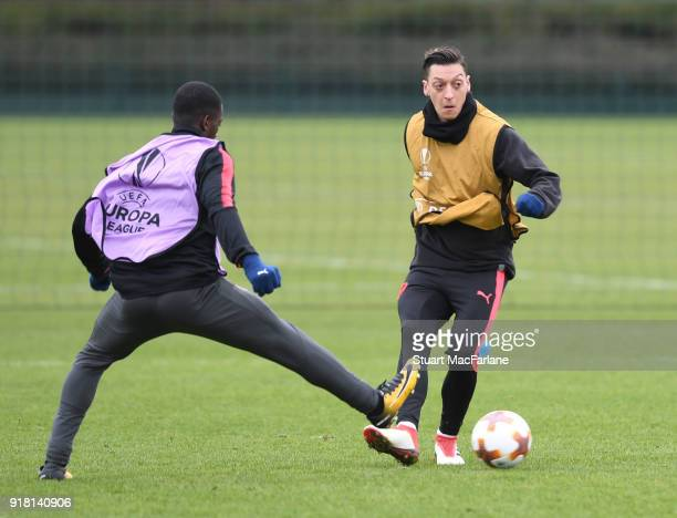 Eddie Nketiah and Mesut Ozil of Arsenal during a training session at London Colney on February 14 2018 in St Albans United Kingdom
