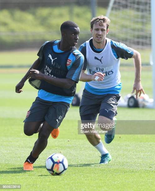 Eddie Nketiah and Nacho Monreal of Arsenal during a training session at London Colney on May 8 2018 in St Albans England