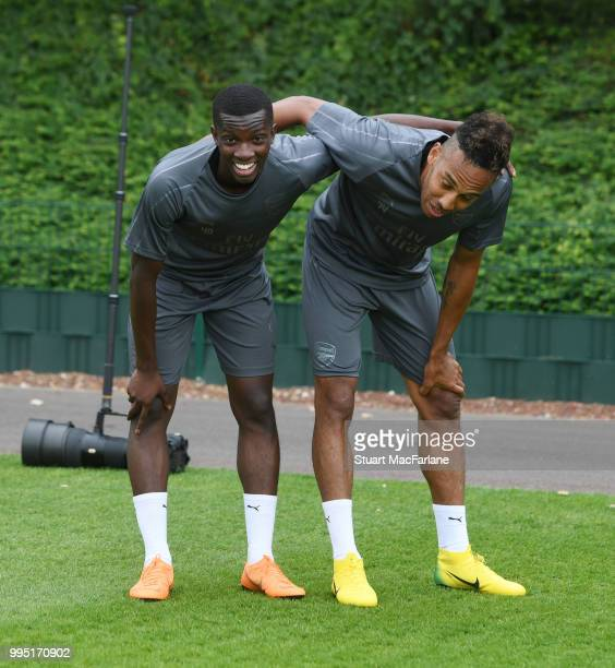 Eddie Nketiah and PierreEmerick Aubameyang of Arsenal after a training session at London Colney on July 10 2018 in St Albans England