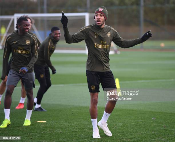 Eddie Nketiah and PierreEmerick Aubameyang of Arsenal during a training session at London Colney on December 7 2018 in St Albans England