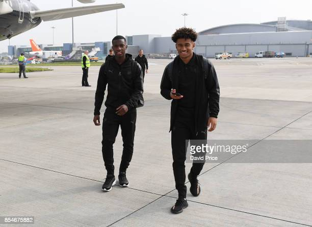 Eddie Nketiah and Reiss Nelson of Arsenal board the plane at Luton Airport on September 27 2017 in Luton England