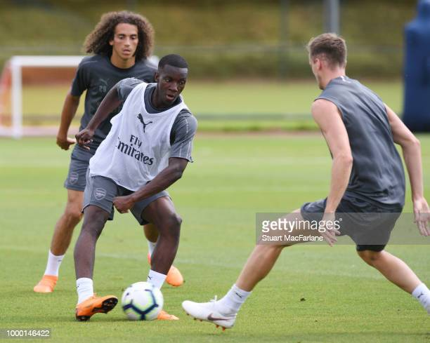 Eddie Nketiah and Rob Holding of Arsenal during a training session at London Colney on July 16 2018 in St Albans England