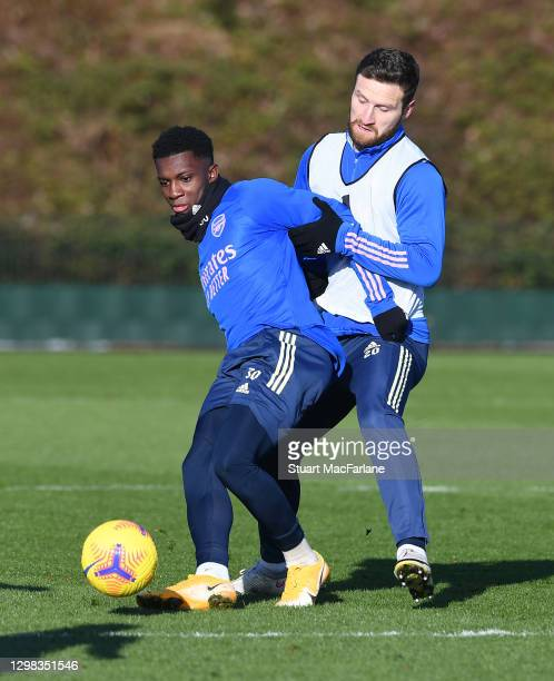 Eddie Nketiah and Shkodran Mustafi of Arsenal during a training session at London Colney on January 25, 2021 in St Albans, England.
