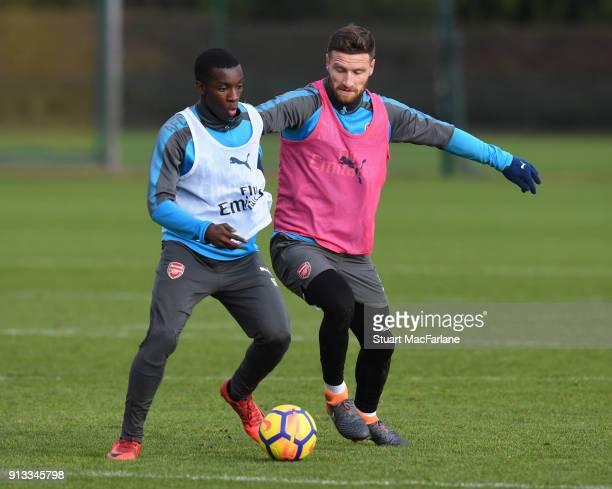 Eddie Nketiah and Shkodran Mustafi of Arsenal during a training session at London Colney on February 2 2018 in St Albans England