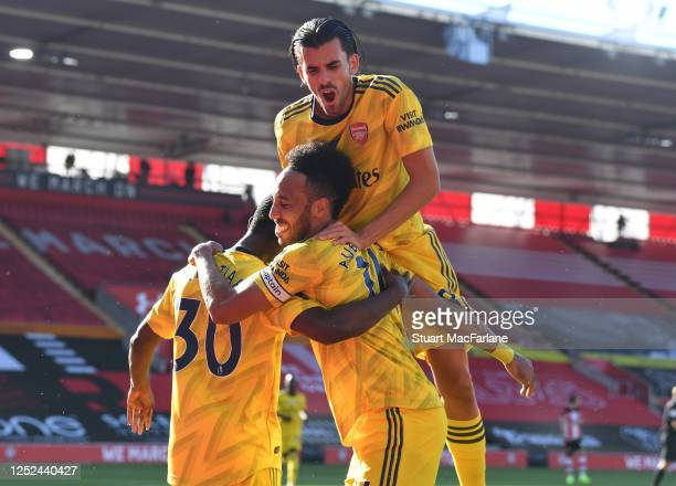 Eddie Nketiah celebrates his goal with Pierre-Emerick Aubameyang and Dani Ceballos during the Premier League match between Southampton FC and Arsenal...