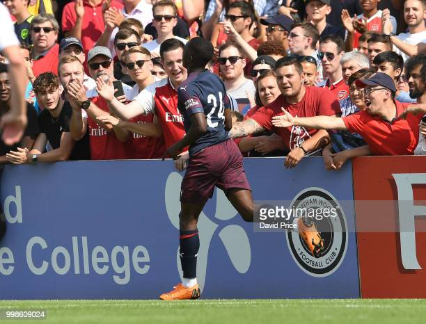 Eddie Nketiah celebrates scoring a goal for Arsenal during the match between Borehamwood and Arsenal at Meadow Park on July 14 2018 in Borehamwood...