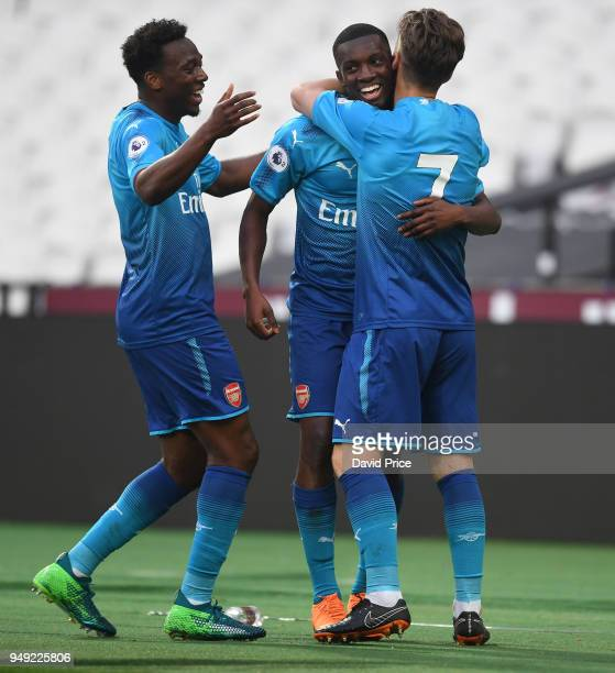 Eddie Nketiah celebrates scoring Arsenal's 2nd goal with Vlad Dragomir and Tolaji Bola during the match between West Ham United and Arsenal at London...