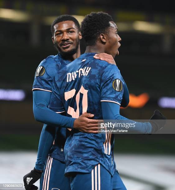 Eddie Nketiah celebrates scoring the 1st Arsenal goal with Ainsley Maitland-Niles during the UEFA Europa League Group B stage match between Dundalk...
