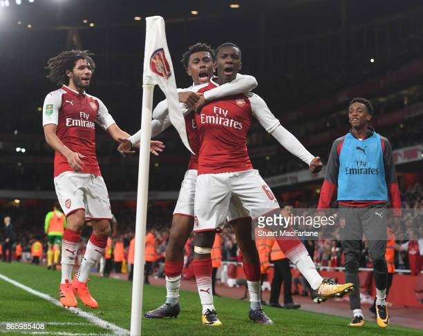 Eddie Nketiah celebrates scoring the 1st Arsenal goal with Alex Iwobi and Mohamed Elneny during the Carabao Cup Fourth Round match between Arsenal...