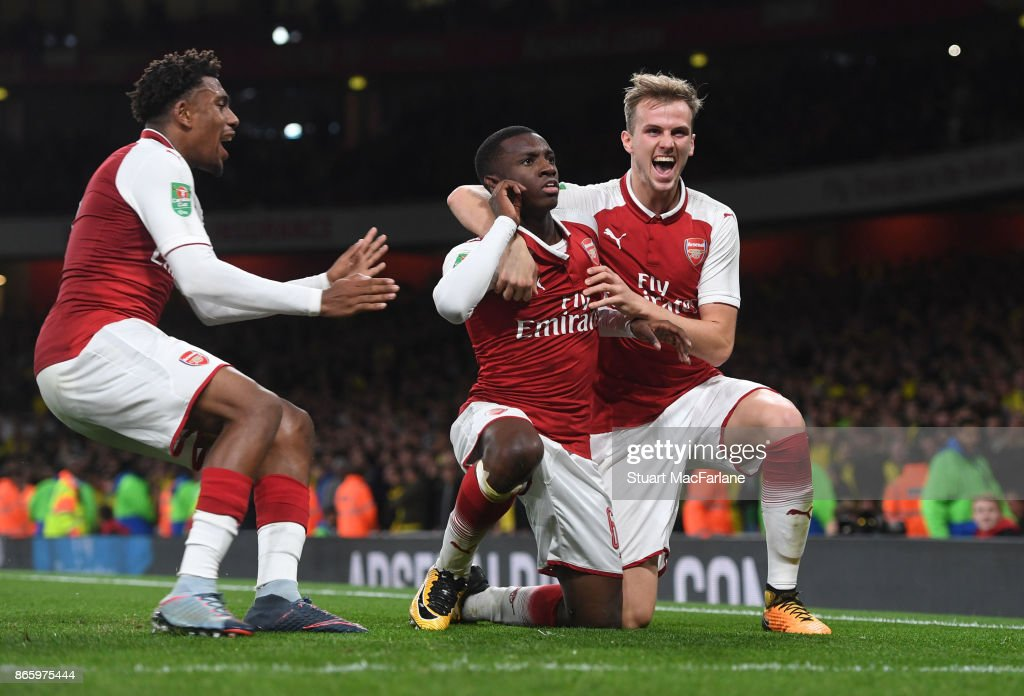 Eddie Nketiah celebrates scoring the 2nd Arsenal goal with (R) Rob Holding and (L) Alex Iwobi during the Carabao Cup Fourth Round match between Arsenal and Norwich City at Emirates Stadium on October 24, 2017 in London, England.
