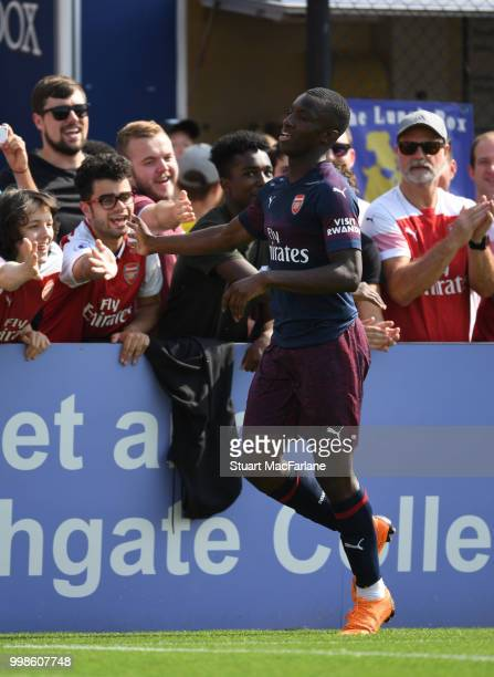 Eddie Nketiah celebrates scring for Arsenal during the preseason friendly between Boreham Wood and Arsenal at Meadow Park on July 14 2018 in...