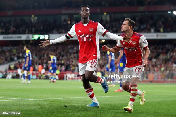 Eddie Nketiah celebrates with Cedric Soares of Arsenal after scoring their team's third goal during the Carabao Cup Third Round match between Arsenal...