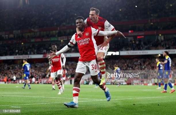 Eddie Nketiah celebrates with teammate Cedric Soares of Arsenal after scoring their team's third goal during the Carabao Cup Third Round match...