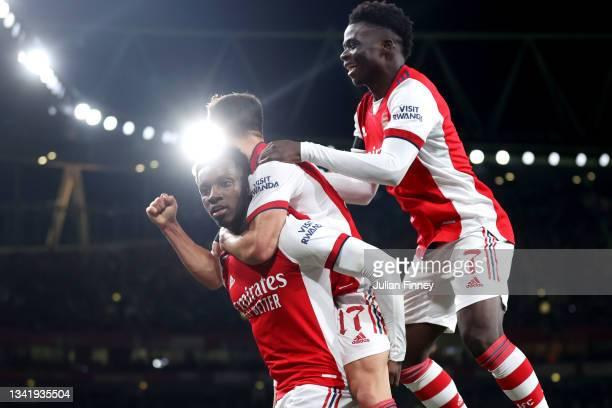 Eddie Nketiah celebrates with teammates Cedric Soares and Bukayo Saka of Arsenal after scoring their team's third goal during the Carabao Cup Third...