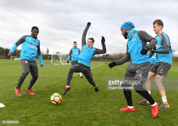 Eddie Nketiah Hector Bellerin Alex Lacazette and Rob Holding of Arsenal during a training session at London Colney on February 2 2018 in St Albans...