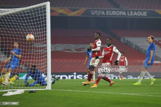 Eddie Nketiah of Arsenal and Nicolas Pepe of Arsenal look on as Sheriff Sinyan of Molde scores an own goal giving arsenal their second goal during...