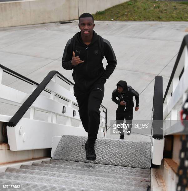 Eddie Nketiah of Arsenal boards the plane at Luton Airport on November 22 2017 in Luton England