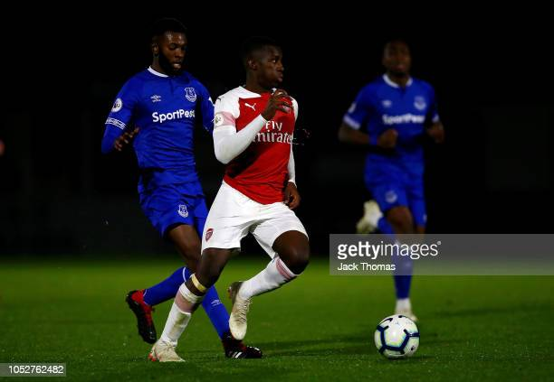 Eddie Nketiah of Arsenal breaks away from Beni Baningime of Everton during the Premier League 2 match between Arsenal and Everton at Meadow Park on...
