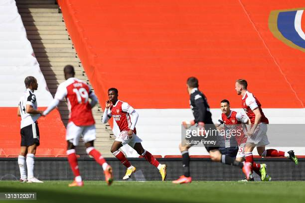 Eddie Nketiah of Arsenal celebrates after scoring his team's first goal during the Premier League match between Arsenal and Fulham at Emirates...