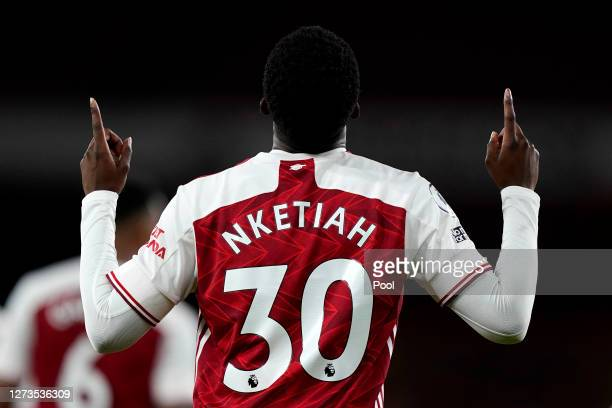 Eddie Nketiah of Arsenal celebrates after scoring his team's second goal during the Premier League match between Arsenal and West Ham United at...