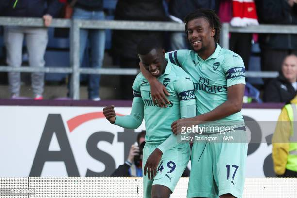 Eddie Nketiah of Arsenal celebrates with Alex Iwobi of Arsenal after scoring a goal to make it 1-3 during the Premier League match between Burnley FC...