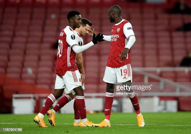 Eddie Nketiah of Arsenal celebrates with teammate Cedric Soares and Nicolas Pepe of Arsenal after scoring his team's first goal during the UEFA...