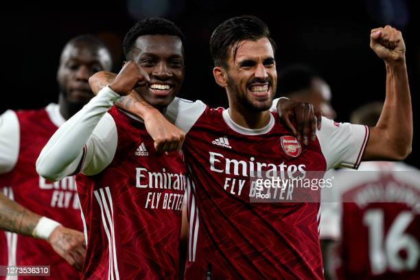 Eddie Nketiah of Arsenal celebrates with teammate Dani Ceballos after scoring his team's second goal during the Premier League match between Arsenal...