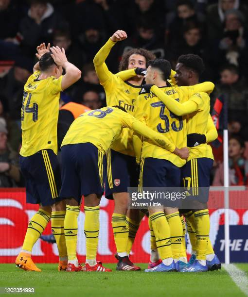 Eddie Nketiah of Arsenal celebrates with teammates after scoring his sides second goal during the FA Cup Fourth Round match between AFC Bournemouth...
