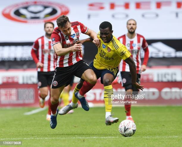 Eddie Nketiah of Arsenal challenged by John Egan of Sheffield United during the FA Cup Fifth Quarter Final match between Sheffield United and Arsenal...
