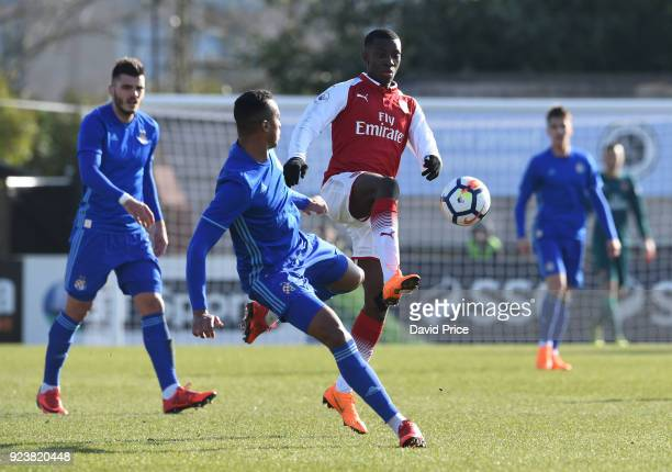 Eddie Nketiah of Arsenal challenges Dos Santos Gabriel Magalhaes of Dinamo during the match between Arsenal and Dinamo Zagreb at Meadow Park on...