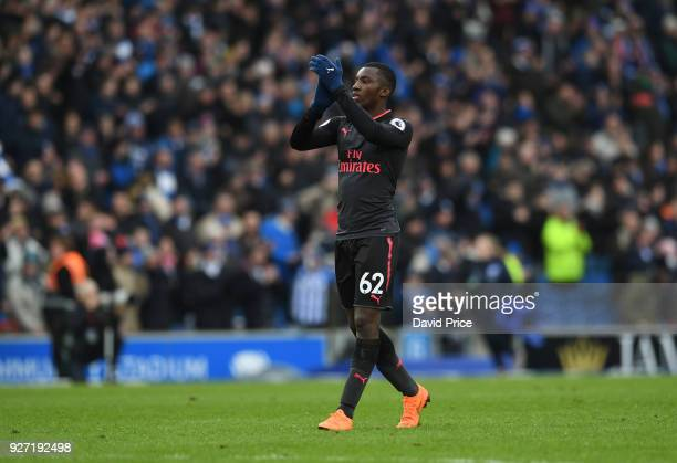 Eddie Nketiah of Arsenal claps the fans after the Premier League match between Brighton and Hove Albion and Arsenal at Amex Stadium on March 4 2018...