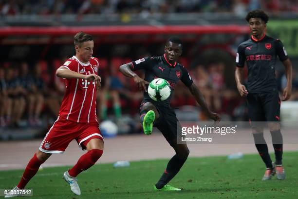 Eddie Nketiah of Arsenal FC of Arsenal FC competes for the ball with Marco Friedl of FC Bayern during the 2017 International Champions Cup football...