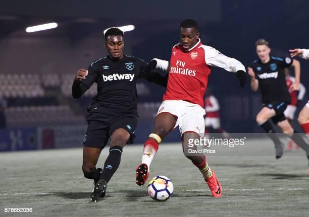 Eddie Nketiah of Arsenal holds off Olatunji Akinola of West Ham during the Premier League Two match between Arsenal U23 and West Ham United U23 at...