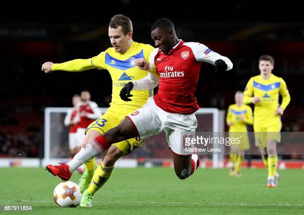 Eddie Nketiah of Arsenal holds off pressure from Denis Polyakov of BATE Borisov during the UEFA Europa League group H match between Arsenal FC and...