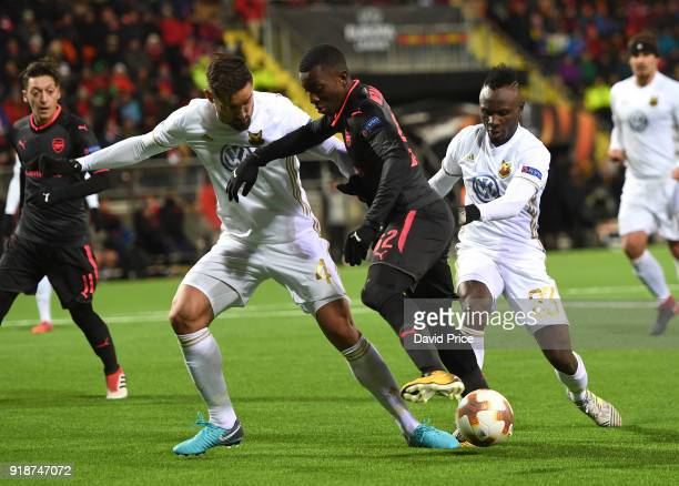 Eddie Nketiah of Arsenal is challenged by Sotirios Papagiannopoulos and Samuel Mensah of Ostersunds during UEFA Europa League Round of 32 match...