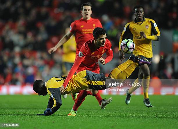 Eddie Nketiah of Arsenal is challenged by Tiago Ilori of Liverpool during the Premier League match between Arsenal and Stoke City at Anfield on...