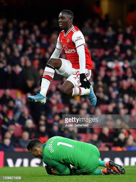Eddie Nketiah of Arsenal jumps over Martin Dubravka of Newcastle United during the Premier League match between Arsenal FC and Newcastle United at...