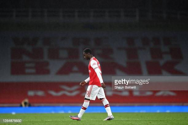 Eddie Nketiah of Arsenal leaves the pitch following being shown a red card after a VAR decision during the Premier League match between Arsenal FC...