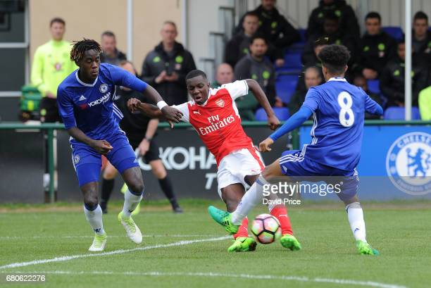 Eddie Nketiah of Arsenal shoots under pressure from Trevoh Chalobah and Jacob Maddox of Chelsea during the U18 Premier League match between Chelsea...
