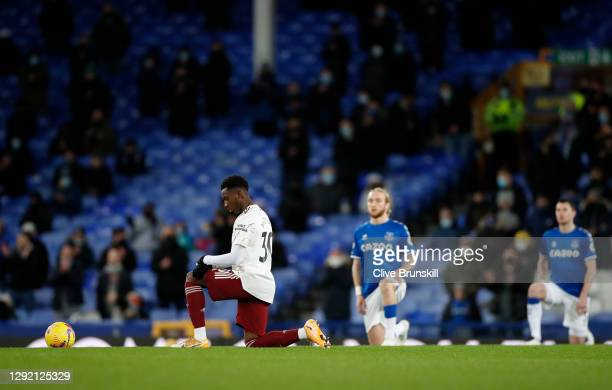 Eddie Nketiah of Arsenal takes a knee in support of the 'Black Lives Matter' movement during the Premier League match between Everton and Arsenal at...