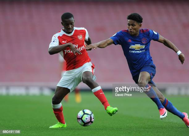 Eddie Nketiah of Arsenal takes on Demetri Mitchell of Man Utd during the Premier League 2 match between Arsenal U23 and Manchester United U23 at...