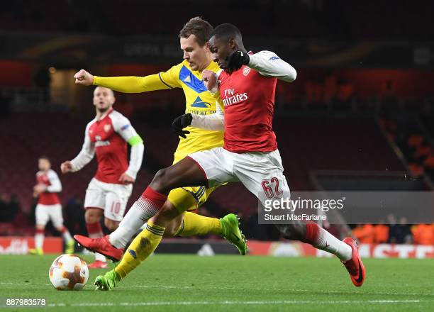 Eddie Nketiah of Arsenal takes on Denis Polyakov of BATE during the UEFA Europa League group H match between Arsenal FC and BATE Borisov at Emirates...