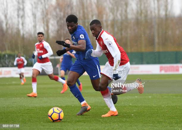 Eddie Nketiah of Arsenal takes on Joseph Colley of Chelsea during the match between Arsenal U23 and Chelsea U23 at London Colney on March 17 2018 in...