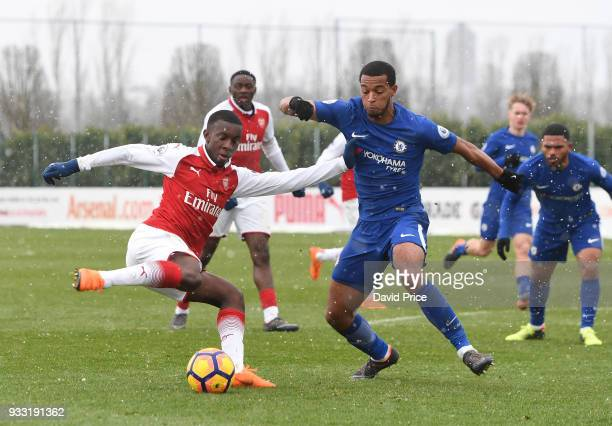 Eddie Nketiah of Arsenal under pressure from Josh Grant of Chelsea during the match between Arsenal U23 and Chelsea U23 at London Colney on March 17...